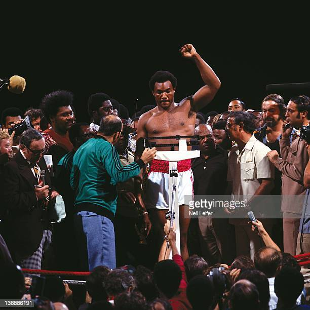 Boxing WBC/ WBA World Heavyweight Title George Foreman during weighin as Angelo Dundee works the scale before fight vs Muhammad Ali at Stade du 20...