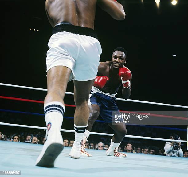 Boxing WBC/ WBA World Heavyweight Title Joe Frazier in action crouching for position vs Muhammad Ali during fight at Araneta Coliseum Quezon City...