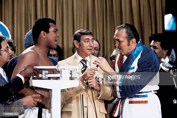 Boxing WBC/ WBA World Heavyweight Title Muhammad Ali and and Chuck Wepner with ABC's Wide World of Sports commentator Howard Cosell during weighin...