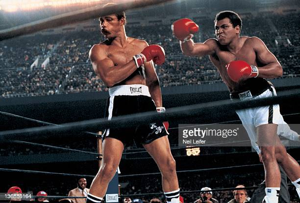 Boxing WBC/ WBA World Heavyweight Title Muhammad Ali in action right hook punch vs Ken Norton during fight at Yankee Stadium Bronx NY 9/28/1976...