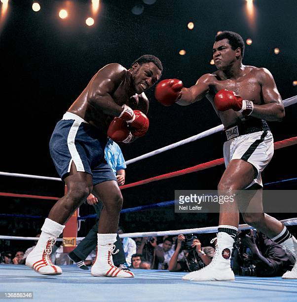 Boxing WBC/ WBA World Heavyweight Title Muhammad Ali in action throwing right punch vs Joe Frazier during fight at Araneta Coliseum Cover Quezon City...
