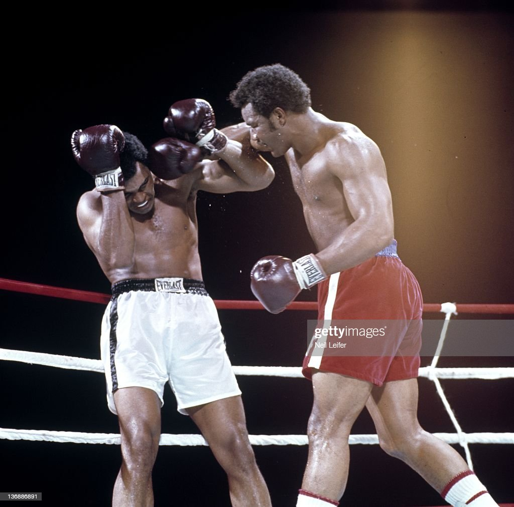 WBC/ WBA World Heavyweight Title: Muhammad Ali in action, taking punch from George Foreman against the ropes during fight at Stade du 20 Mai. Kinshasa, Zaire