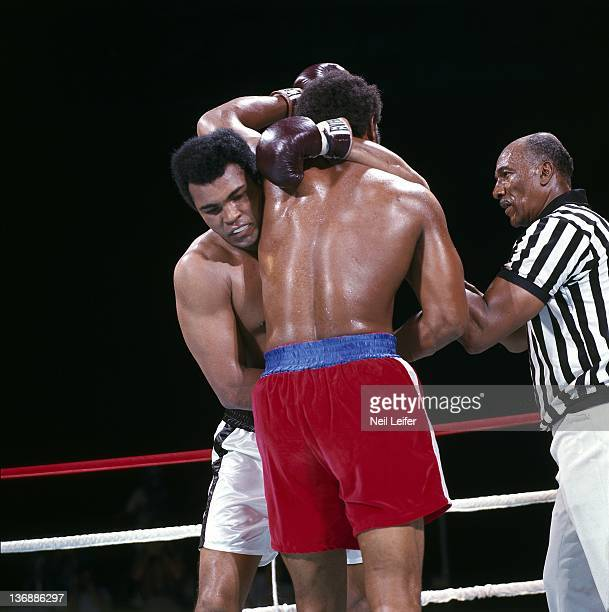 Boxing: WBC/ WBA World Heavyweight Title: Muhammad Ali in action vs George Foreman during fight at Stade du 20 Mai. View of referee Zach Clayton....