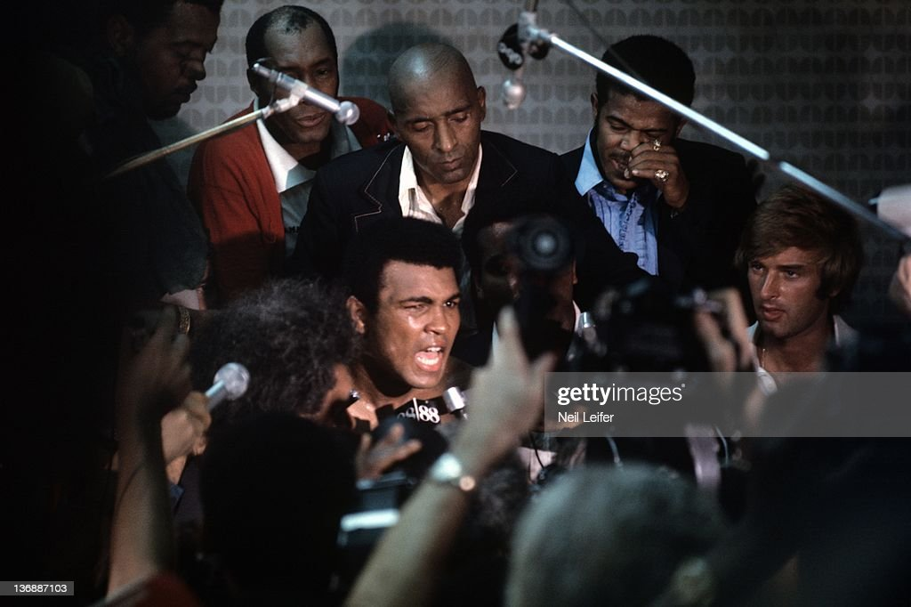 WBC/ WBA World Heavyweight Title: Muhammad Ali victorious during media press conference after winning fight with round 8 knockout of George Foreman at Stade du 20 Mai. Kinshasa, Zaire