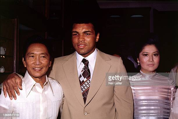 Boxing WBC/ WBA World Heavyweight Title Muhammad Ali with Filipino President Ferdinand Marcos and First Lady Imelda Marcos during party after winning...