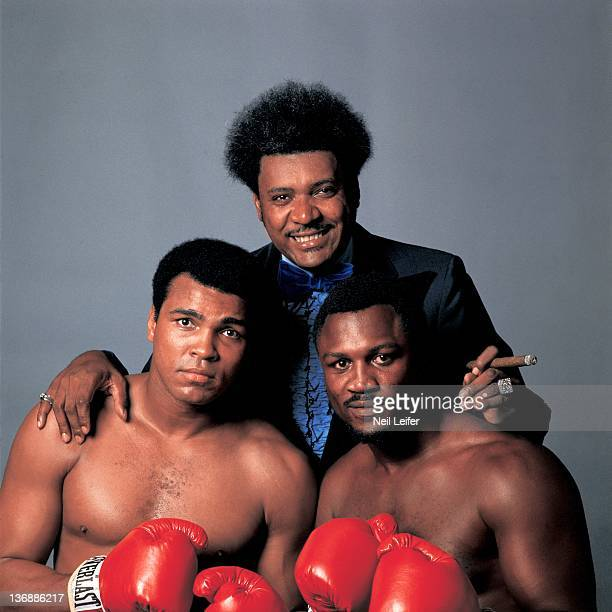 Boxing WBC/ WBA World Heavyweight Title Preview Closeup portrait of promoter Don King with Muhammad Ali and Joe Frazier during photo shoot at Life...
