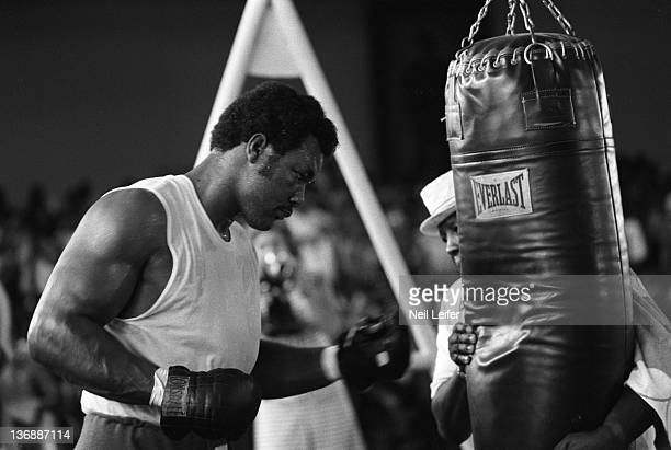 Boxing WBC/ WBA World Heavyweight Title Preview George Foreman hitting heavy bag while training before fight vs Muhammad Ali at the Salle de Congres...