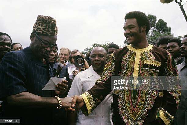 Boxing WBC/ WBA World Heavyweight Title Preview George Foreman with Zaire President Mobutu Sese Seku during reception before fight vs Muhammad Ali at...