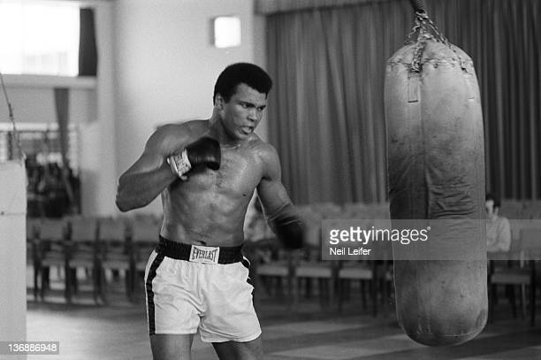 Boxing WBC/ WBA World Heavyweight Title Preview Muhammad Ali hitting heavy bag while training before fight vs George Foreman at the Salle de Congres...