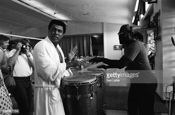 Boxing WBC/ WBA World Heavyweight Title Preview Muhammad Ali playing bongos while training before fight vs George Foreman at the Salle de Congres in...