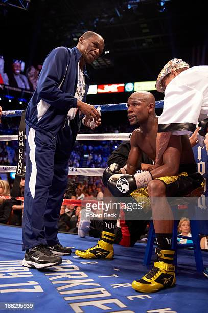 WBC Welterweight Title Floyd Mayweather Jr in corner with his uncle and trainer Roger Mayweather during fight vs Robert Guerrero at MGM Grand Garden...