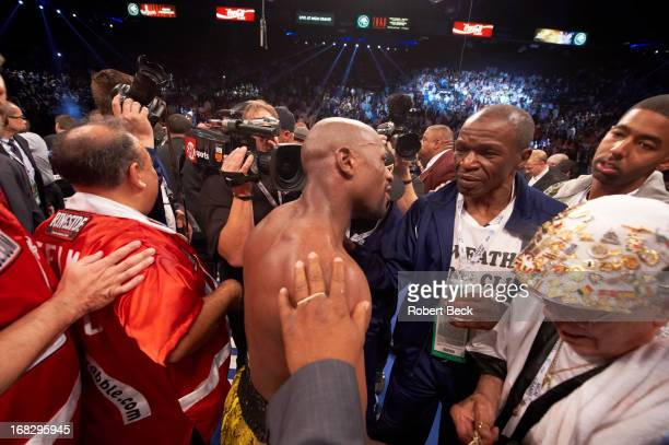 WBC Welterweight Title Floyd Mayweather Jr victorious with his uncle and trainer Roger Mayweather after winning fight vs Robert Guerrero at MGM Grand...