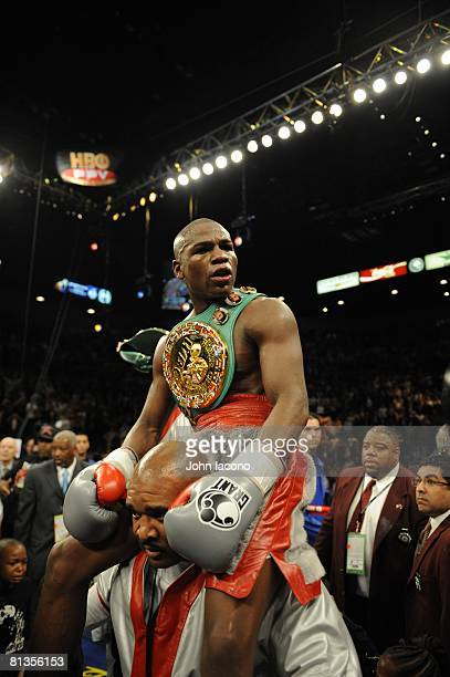 Boxing WBC Welterweight Title Floyd Mayweather Jr victorious with championship trophy belt after winning fight vs Ricky Hatton at MGM Grand Garden...