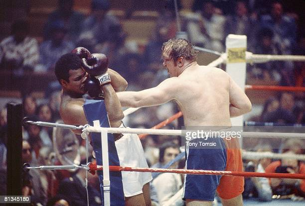 Boxing WBC/WBA Heavyweight Title Chuck Wepner in action throwing punch vs Muhammad Ali at Richfield Coliseum Richfield OH 3/24/1975