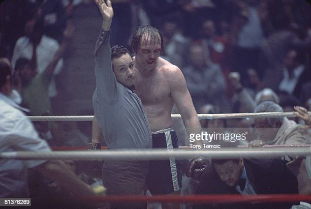Boxing: WBC/WBA Heavyweight Title, Chuck Wepner with referee, calling TKO after fight vs Muhammad Ali at Richfield Coliseum, Richfield, OH 3/24/1975