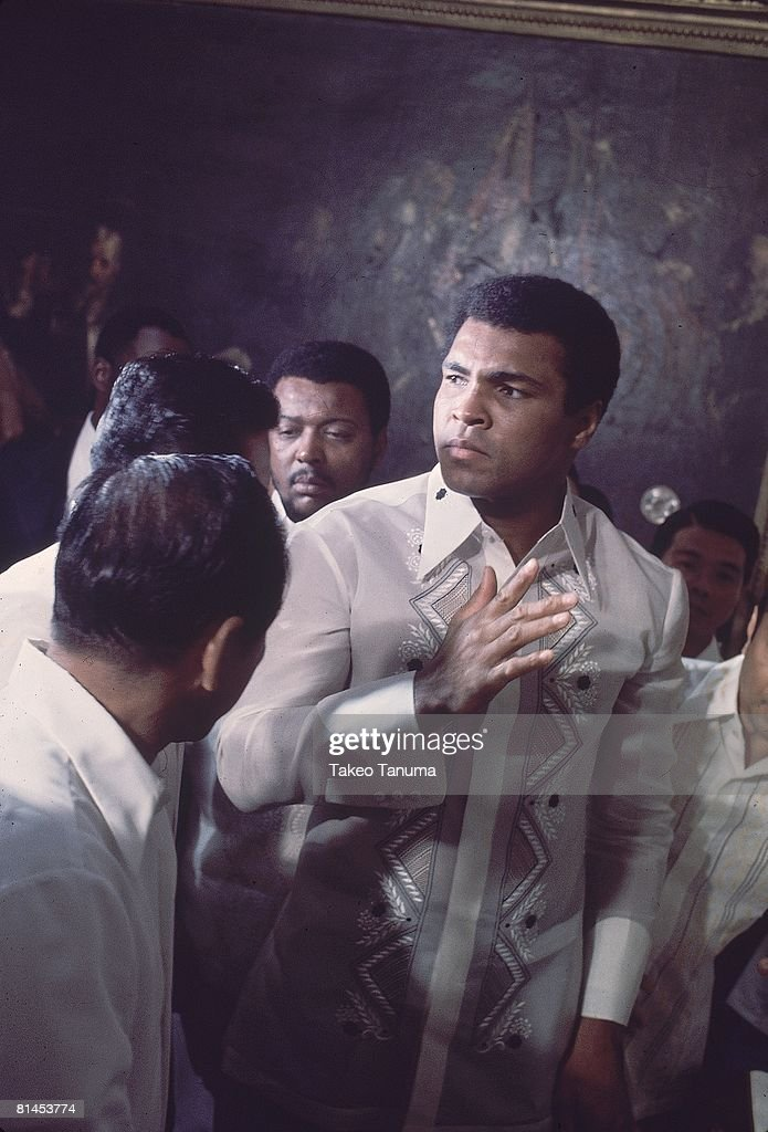 WBC/WBA Heavyweight Title, Closeup of Muhammad Ali with fans during training for fight vs Joe Frazier, Manila, PHL 10/1/1975