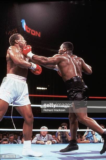 Boxing: WBC/WBA Heavyweight Title, Mike Tyson in action, throwing left hook punch vs Pinklon Thomas at Hilton Hotel, Las Vegas, NV 5/30/1987