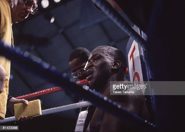 Boxing WBC/WBA/IBF Heavyweight Title Closeup of James Buster Douglas in corner during fight vs Mike Tyson at Tokyo Dome Tokyo Japan 2/11/1990