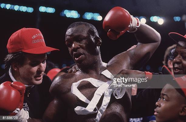 Boxing WBC/WBA/IBF Heavyweight Title Closeup of James Buster Douglas victorious after winning fight vs Mike Tyson at Tokyo Dome Tokyo Japan 2/11/1990