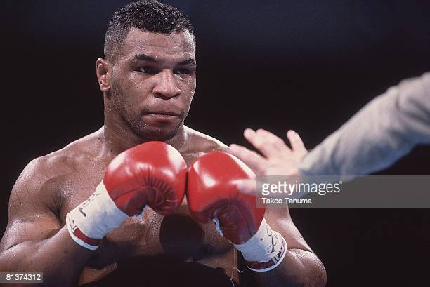 Boxing WBC/WBA/IBF Heavyweight Title Closeup of Mike Tyson during fight vs James Buster Douglas at Tokyo Dome Tokyo Japan 2/11/1990