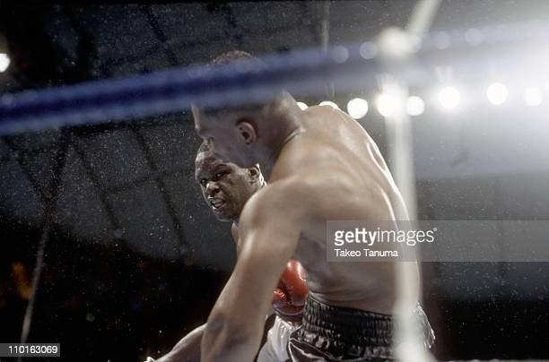 WBC/WBA/IBF Heavyweight Title James Buster Douglas in action making knockout punch vs Mike Tyson at Tokyo DomeTokyo Japan 2/11/1990CREDIT Takeo Tanuma