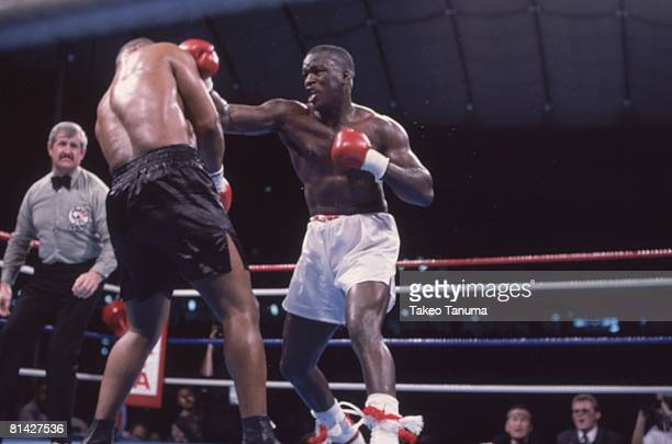 Boxing WBC/WBA/IBF Heavyweight Title James Buster Douglas in action throwing punch vs Mike Tyson at Tokyo Dome Tokyo Japan 2/11/1990