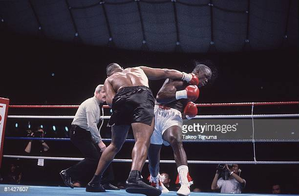 Boxing WBC/WBA/IBF Heavyweight Title James Buster Douglas in action taking punch vs Mike Tyson at Tokyo Dome Tokyo Japan 2/11/1990