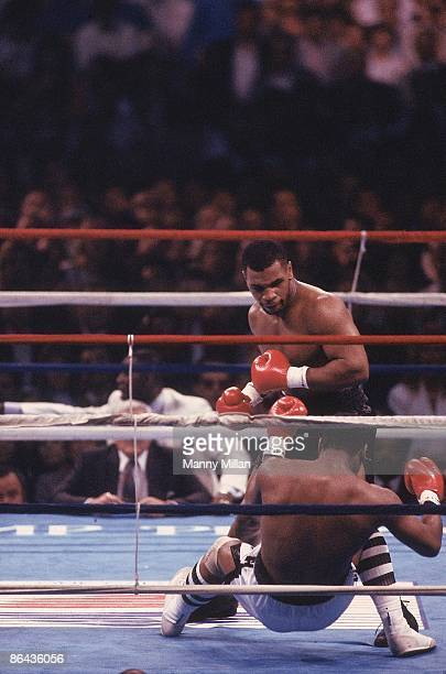 Heavyweight Title: Mike Tyson in action during knock out vs Michael Spinks after 91 seconds of fight at Convention Hall. Cover. Atlantic City, NJ...