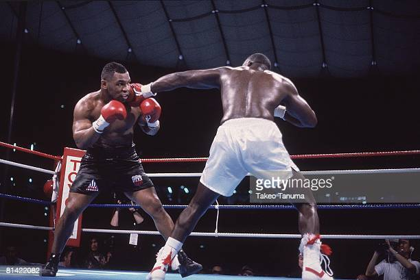 Boxing WBC/WBA/IBF Heavyweight Title Mike Tyson in action vs James Buster Douglas at Tokyo Dome Tokyo Japan 2/11/1990