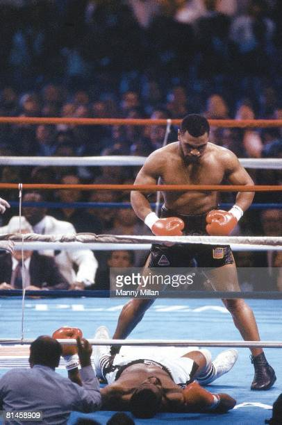 Boxing WBC/WBA/IBF Heavyweight Title Mike Tyson victorious after knocking out Michael Spinks in 91 seconds at Convention Hall Atlantic City NJ...