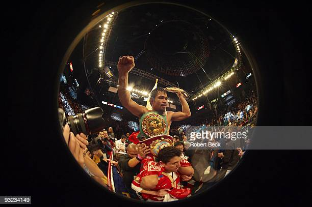 WBO Welterweight Title Fisheye view of Manny Pacquiao victorious holding championship trophy belt after winning fight vs Miguel Cotto at MGM Grand...