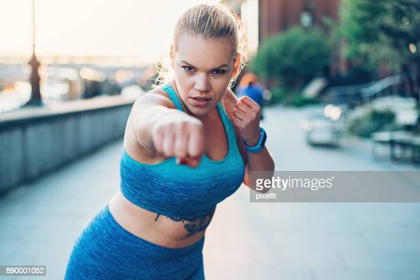 boxing work-out - punching stock pictures, royalty-free photos & images
