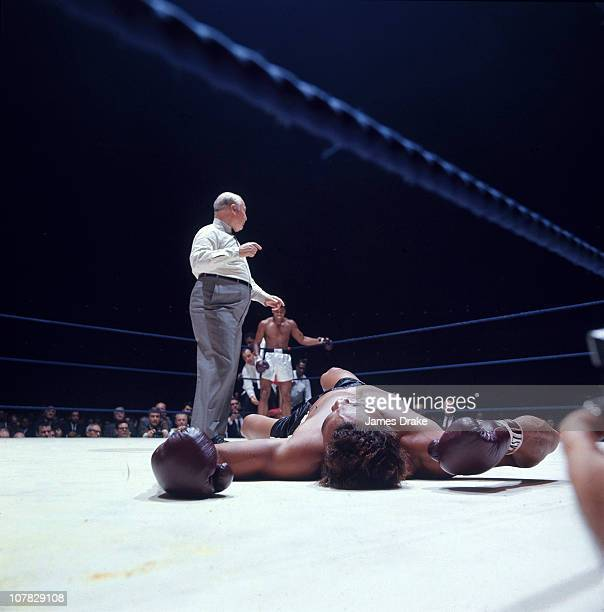 World Heavyweight Title Cleveland Williams down on canvas during fight vs Muhammad Ali at Houston Astrodome View of referee Harry Kessler while Ali...