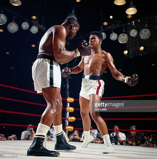 Boxing World Heavyweight Title Muhammad Ali in action left hook punch vs Sonny Liston during fight at Miami Beach Convention Hall Miami Beach FL...
