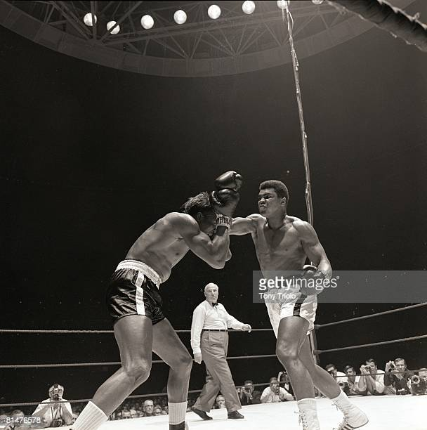 Boxing World Heavyweight Title Muhammad Ali in action throwing punch vs Cleveland Williams at Astrodome Houston TX