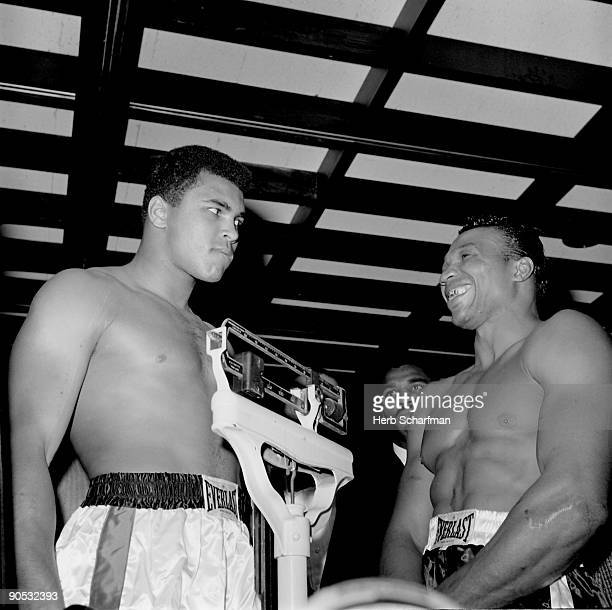 World Heavyweight Title Muhammad Ali standing on scale next to Cleveland Williams during weigh in before fight at Astrodome Houston TX CREDIT Herb...