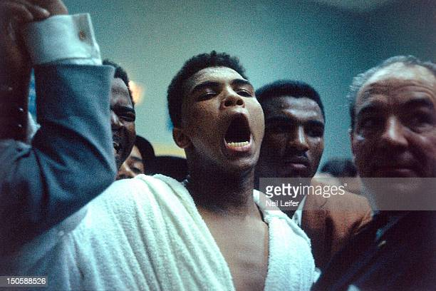 World Heavyweight Title Muhammad Ali taunting Sonny Liston during weighin before fight at Cypress Room of the Miami Beach Convention Hall View of his...