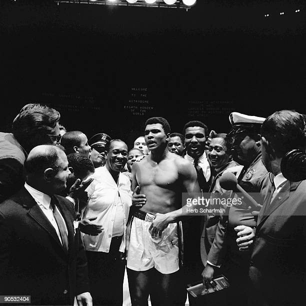 World Heavyweight Title Muhammad Ali victorious walking down aisle with entourage after winning fight vs Cleveland Williams by KO at Astrodome...