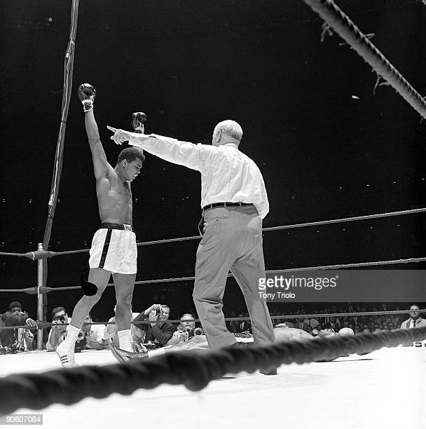 World Heavyweight Title Muhammad Ali victorious with referee Harry Kessler after winning fight vs Cleveland Williams at Astrodome Houston TX CREDIT...