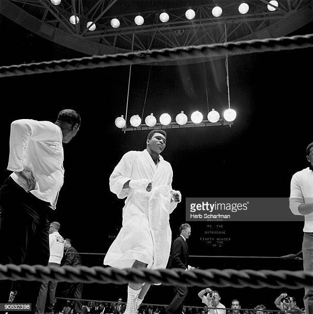 World Heavyweight Title Muhammad Ali wearing robe in ring during introductions before fight vs Cleveland Williams at Astrodome Houston TX CREDIT Herb...