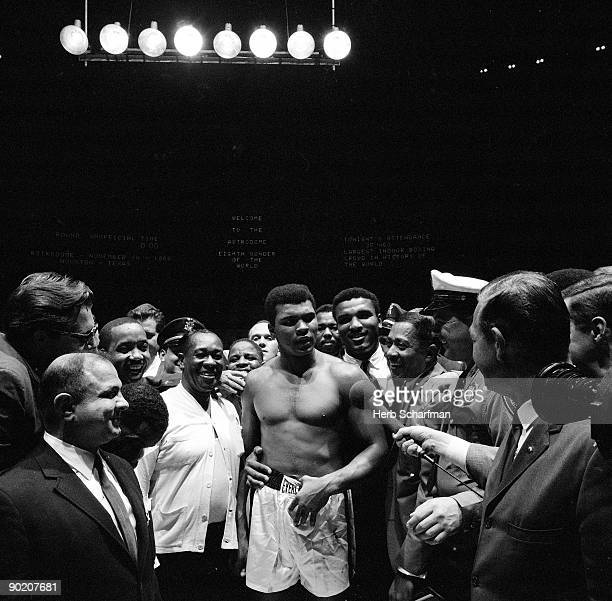 World Heavyweight Title Muhammad Ali with media after fight vs Cleveland Williams at Astrodome Houston TX CREDIT Herb Scharfman