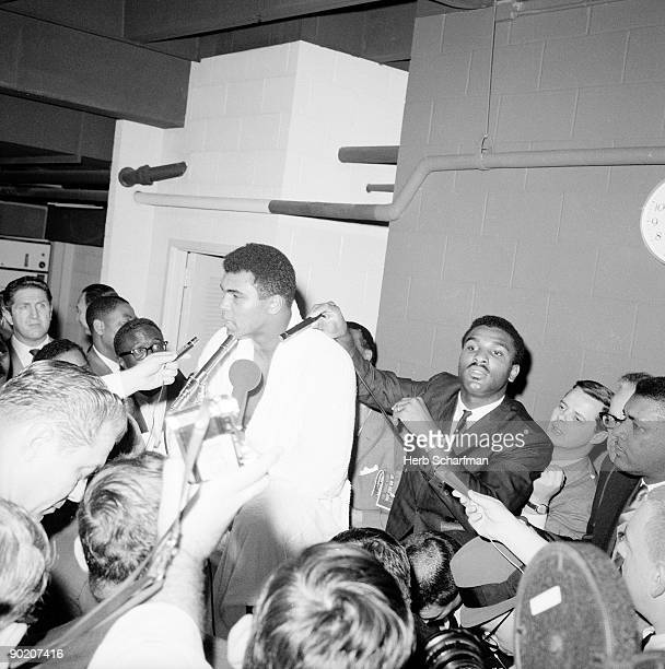 World Heavyweight Title Muhammad Ali with media before fight vs Cleveland Williams at Astrodome Houston TX CREDIT Herb Scharfman
