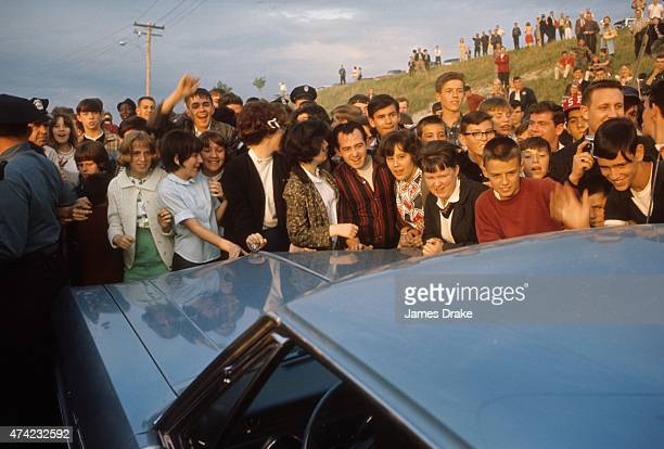 World Heavyweight Title View of fans waiting for Muhammad Ali and Sonny Liston to arrive outside of St Dominic's Arena Auburn ME CREDIT James Drake