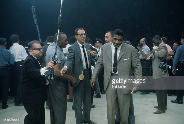 World Heavyweight Title View of Floyd Patterson in ring with referee Jersey Joe Walcott before Muhammad Ali vs Sonny Liston fight at St Dominic's...