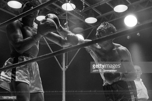 World Middleweight Title Carmen Basilio in action punch vs Sugar Ray Robinson during fight at Yankee Stadium Bronx NY CREDIT John G Zimmerman