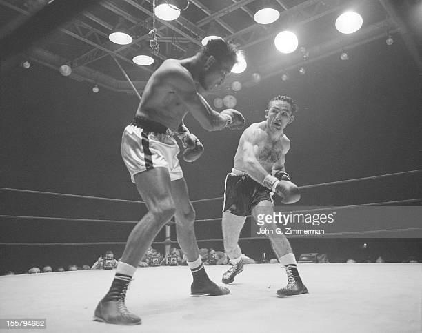 World Middleweight Title Carmen Basilio in action punch vs Sugar Ray Robinson during fight at Yankee Stadium Bronx NY 9/23/1957 CREDIT John G...