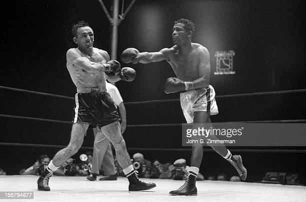 World Middleweight Title Carmen Basilio in action vs Sugar Ray Robinson during fight at Yankee Stadium Bronx NY CREDIT John G Zimmerman