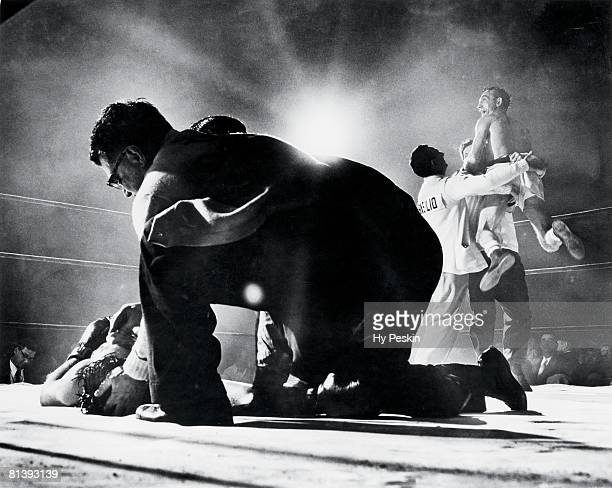 Boxing World Welterweight Title Carmen Basilio victorious with his cornermen after knocking out Tony DeMarco at Boston Garden Boston MA