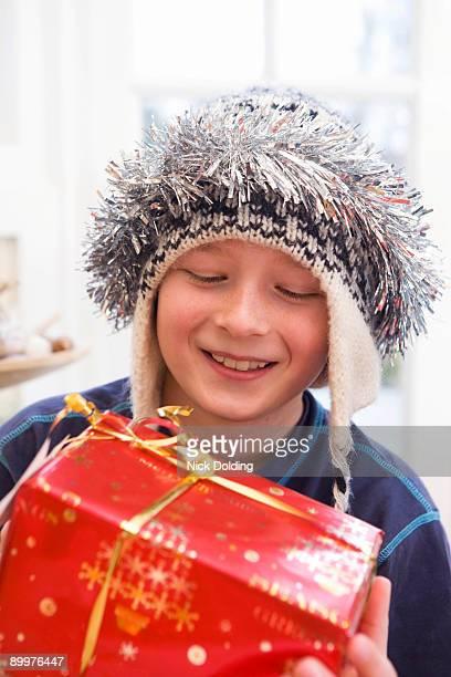 Boy, 10 holding present