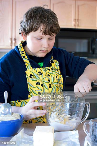 Boy, 12 years old, making cookies
